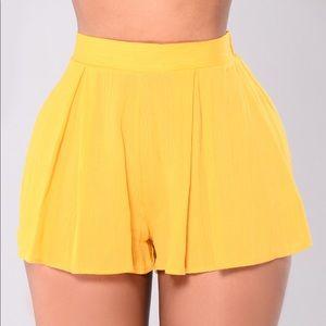 Fashion Nova Rosie Shorts in Mustard